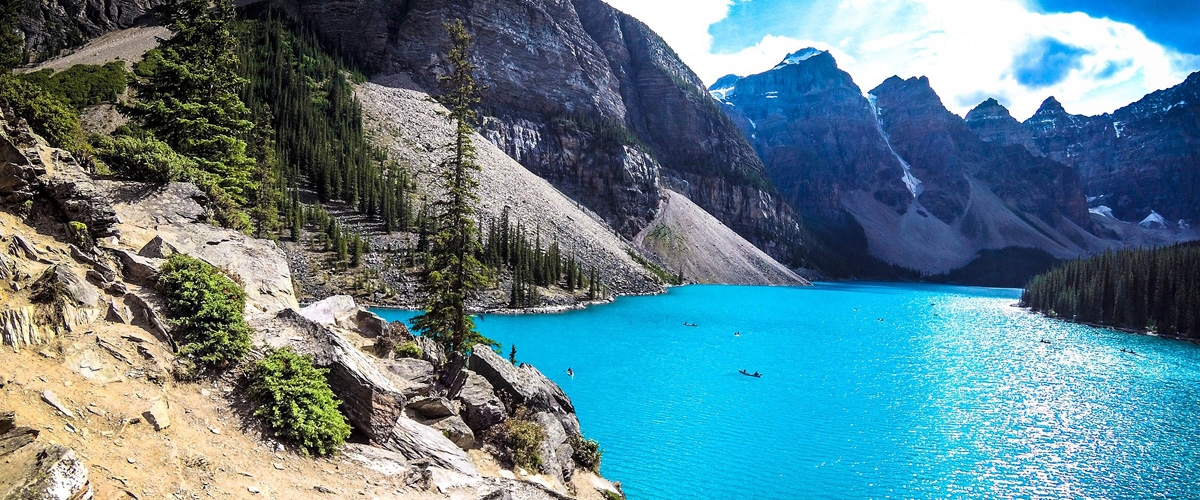 Canadian Rockies with a lake at the bottom. Image is in full colour.